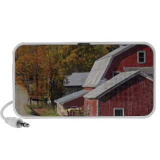 Road beside classic rural barn/farm in autumn, notebook speaker