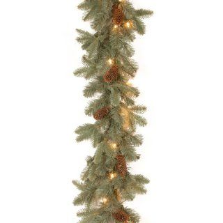 "National Tree 9 Feet by 10 Inch ""Feel Real"" Oak Ridge Blue Garland with 50 Clear Lights   Artificial Christmas Garlands"