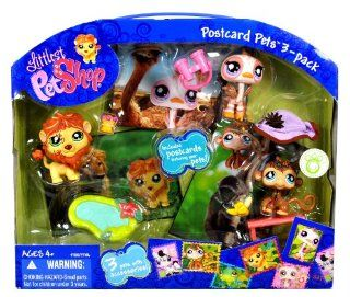 Hasbro Littlest Pet Shop Postcard Pets 3 Pack Bobble Head Pets Figure Set   Lion (#944) with Crown and Pond; Ostrich (#945) with Binoculars and Hat; and Monkey (#946) with Bench and Banana Plus Postcards Featuring the Pets Toys & Games