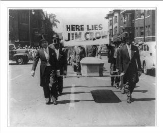 "Historic Print (M) [Pallbearers with casket walking in front of sign reading here lies Jim Crow"" during the"